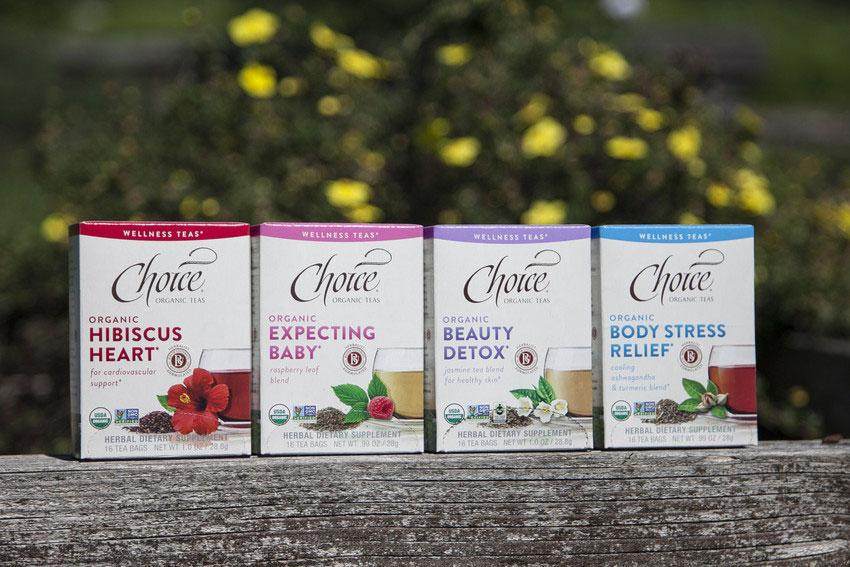 Four boxes of Choice Organic Wellness Teas.