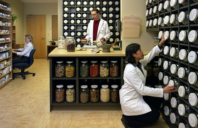 Workers inside the Chinese Herbal Medicine Dispensary.