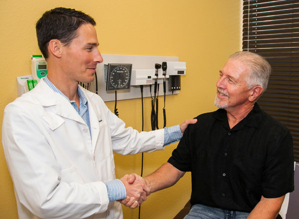Senior shaking hands with naturopathic doctor