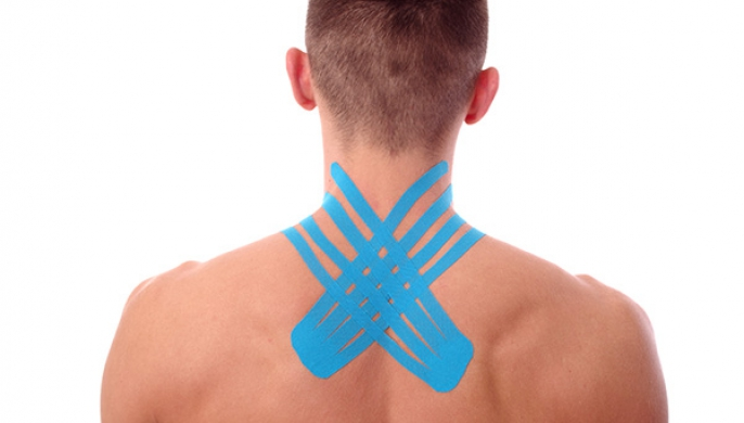 Kinesiology tape on back of neck to reduce chronic pain.